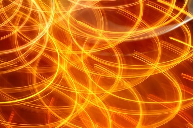 Luci notturne rosse arancio del fondo leggero astratto