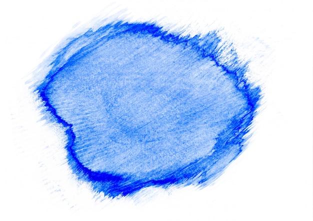 Macchia astratta dell'acquerello blu su sfondo di carta bianca. concetto di arte