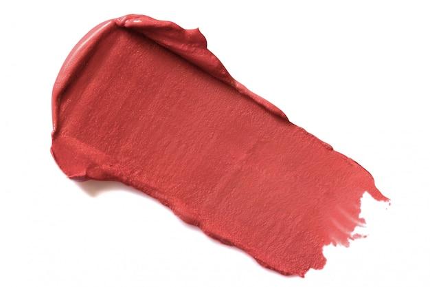 Macchia del rossetto isolata su bianco