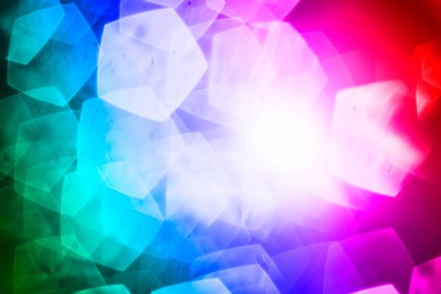Macchie del pentagono su sfondo colorato