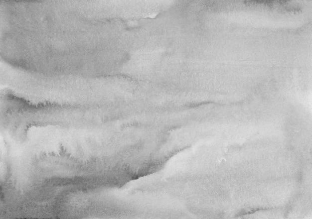 Macchie grige calme dell'acquerello su struttura di carta del fondo. sovrapposizione monocromatica. pittura moderna in bianco e nero dell'acquerello astratto.