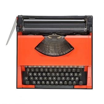 Macchina da scrivere rossa su sfondo bianco