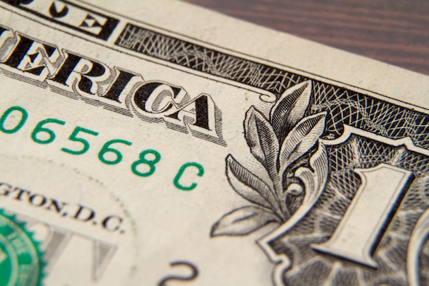 Macro colpo estremo di una banconota in dollari, fuoco selettivo