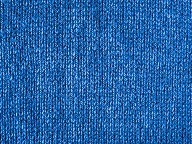 Maglia blu come sfondo tessile.
