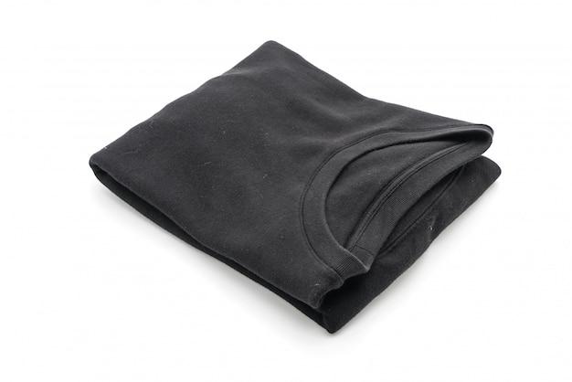 Maglione nero piega su bianco
