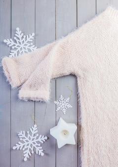Maglione su legno