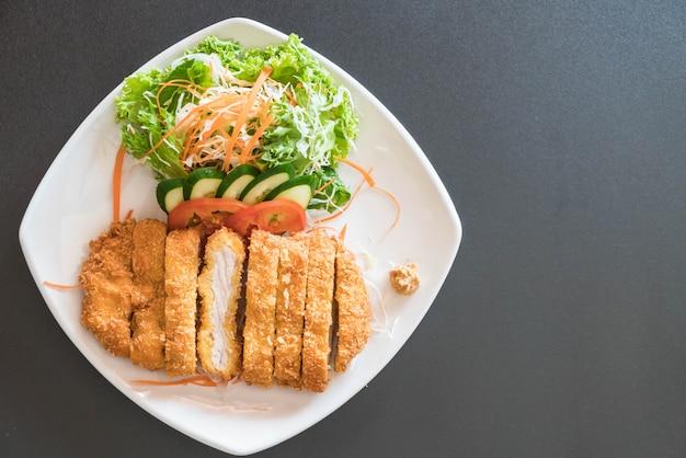 Maiale fritto con verdure cotte