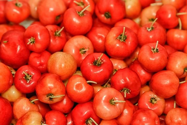 Malpighia glabra (acerola rossa), fondo della frutta tropicale