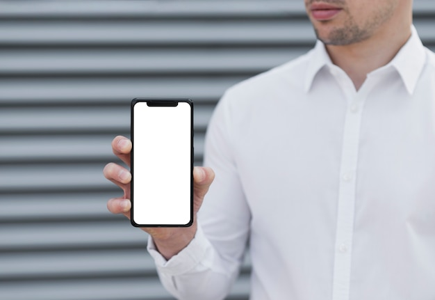 Man holding iphone mock-up