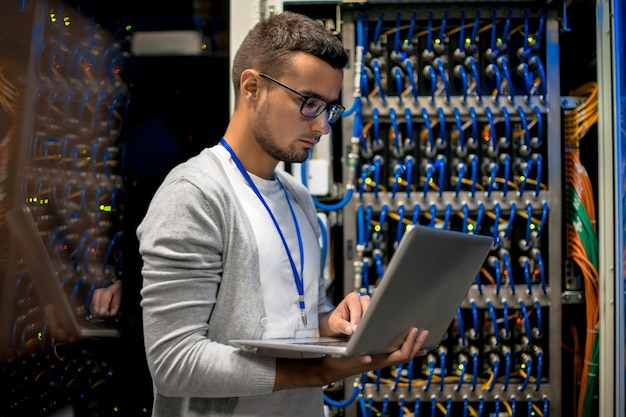 Man managing supercomputer server