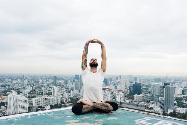 Man practice yoga rooftop concept