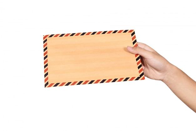 Mani che tengono la busta marrone
