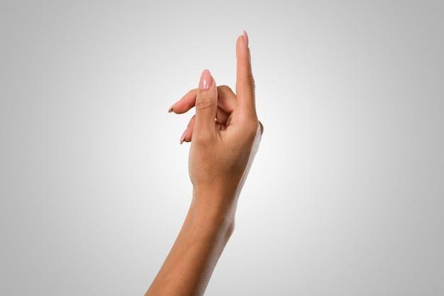 Mani femminili facendo un gesto numero uno