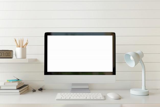 Manichino il computer dello spazio di lavoro con lo schermo in bianco sulla tavola bianca.