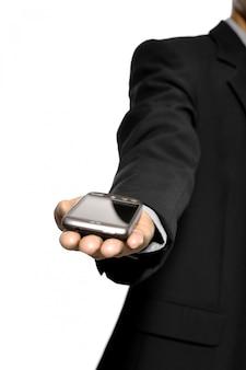 Manifestazione dell'uomo di affari il suo smart phone isolato su fondo bianco