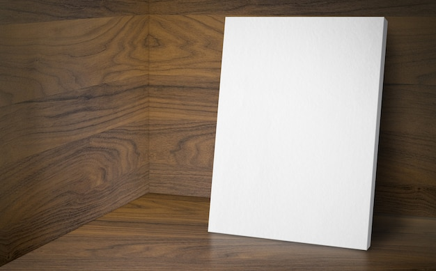 Manifesto in bianco alla stanza dello studio d'angolo con parete e pavimento in legno