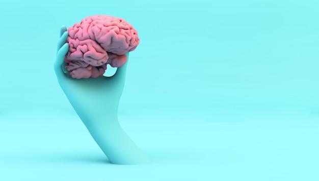 Mano blu che tiene un cervello rosa