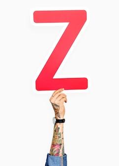 Mano che tiene la lettera z