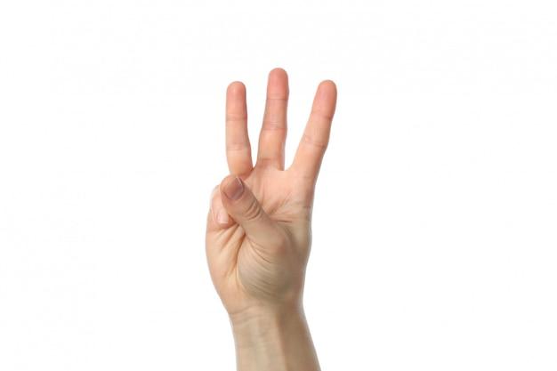 Mano femminile che mostra tre dita, isolate su superficie bianca