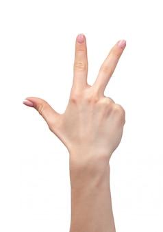 Mano femminile che mostra tre dita su bianco
