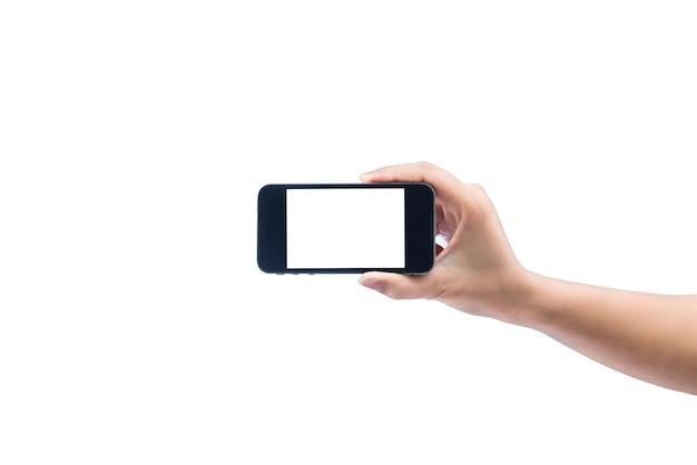 Mano isolata della donna che tiene l'aggeggio del computer di tocco della compressa del telefono