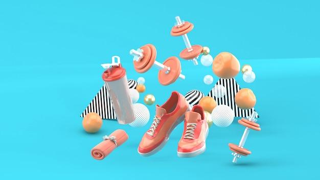 Manubri, scarpe da corsa, asciugamano rosa tra le palline colorate sull'azzurro. rendering 3d