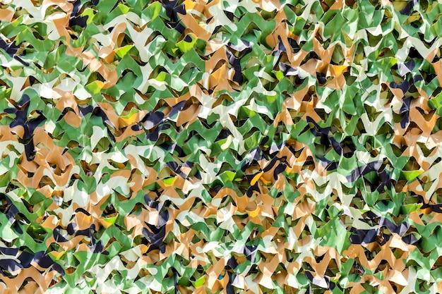 Materiale di abbigliamento foresta di arma marrone marino