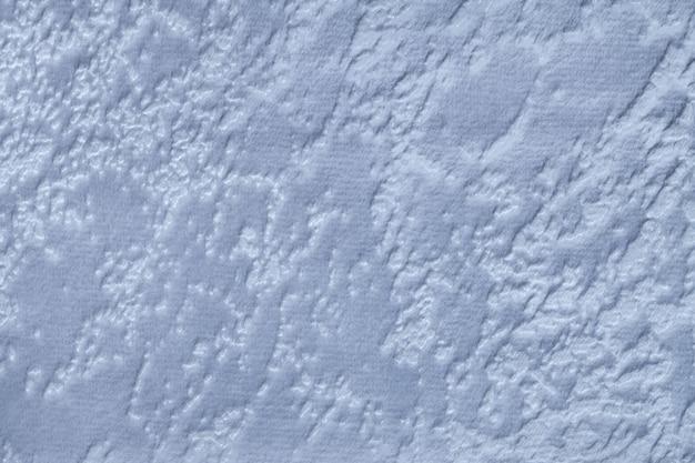 Materiale tessile morbido blu-chiaro della tappezzeria, primo piano.