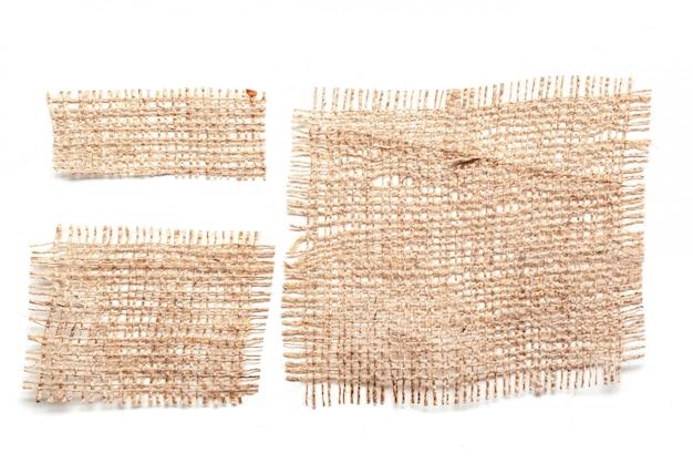 Materiali di tela di sacco isolato su bianco