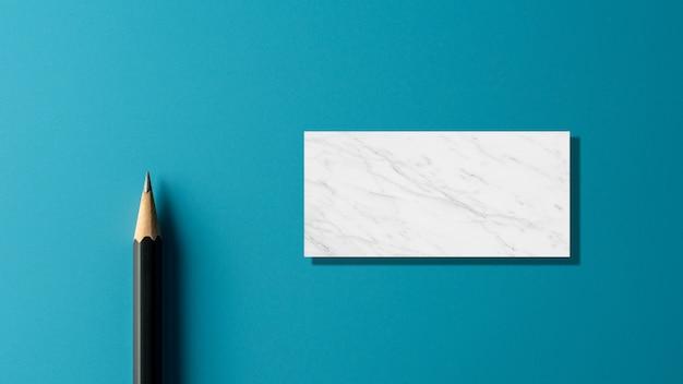 Matita nera su sfondo blu carta. - concetto di business.