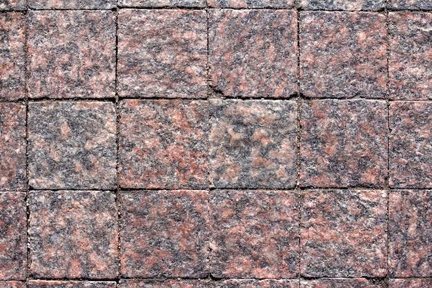 Mattoni quadrati di pietra granito e sabbia