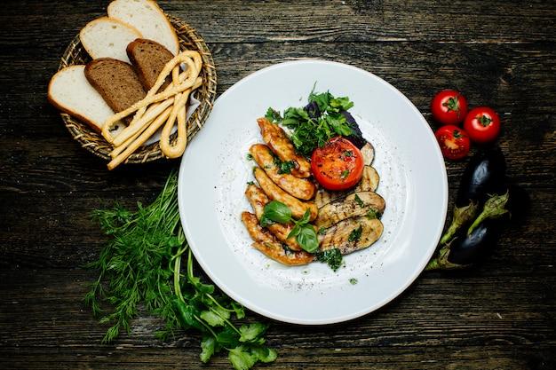 Melanzane e pomodoro fritti con erbe