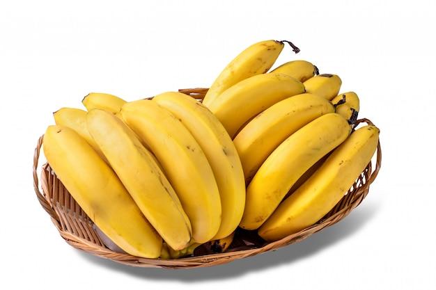 Merce nel carrello dei chiodi di garofano di banana isolata su fondo bianco.