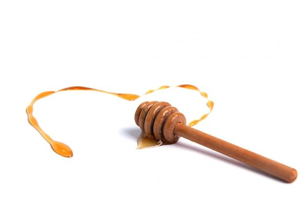 Merlo acquaiolo del miele con miele a forma di cuore