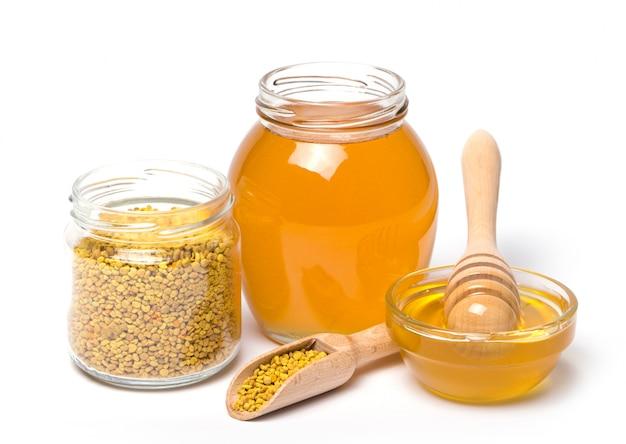 Merlo acquaiolo e vasetti di miele
