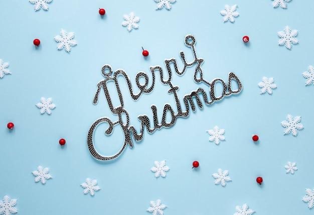 Merry chistmas segno con fiocchi di neve