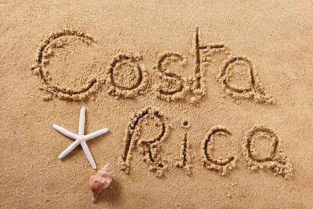 Messaggio di scrittura sulla spiaggia estiva costa rica