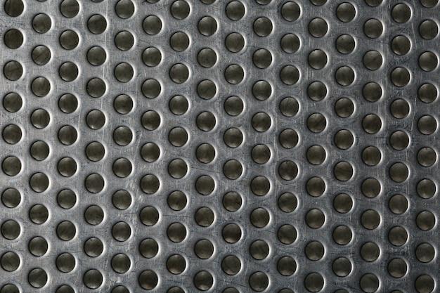 Metallo argentato a forma di nido d'ape per il design.