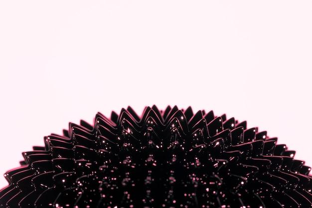 Metallo liquido ferromagnetico con copia spazio su sfondo rosa
