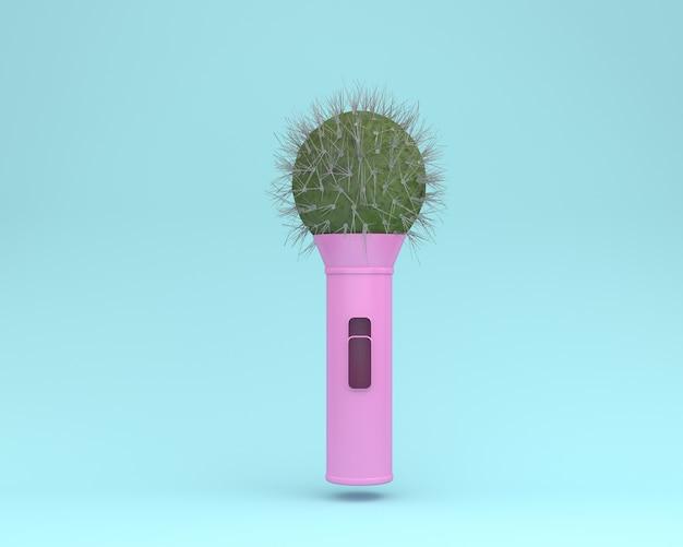 Microfono del cactus della disposizione creativa che galleggia sul pastello blu