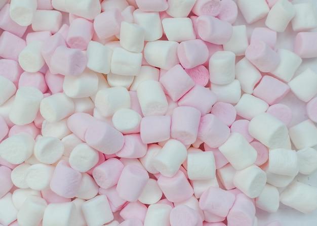 Mini rosa e bianco marshmallows sfondo