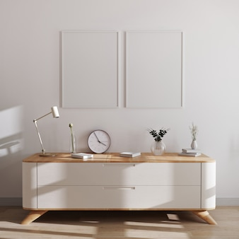 Mockup di cornici di poster in interni moderni. cornici vuote sopra la cassettiera bianca con bellissime decorazioni. stile scandinavo, cornice mockup, rendering 3d