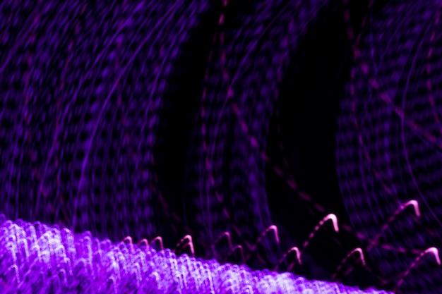 Modelli di luce striduli su sfondo nero
