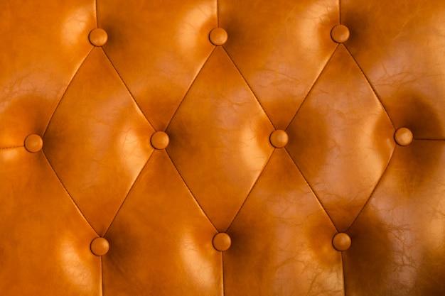 Modello alto vicino del sofà di cuoio