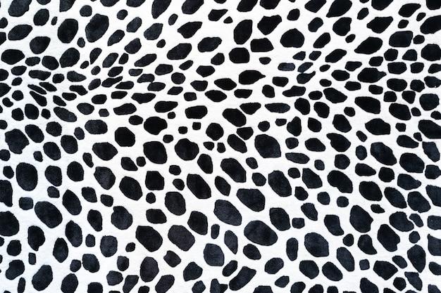 Modello animale senza cuciture per la progettazione tessile. modello senza cuciture di macchie dalmatian. trame naturali