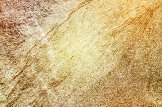Modello del marmo dell'estratto di tono di arte di superficie del primo piano del fondo di marmo marrone di struttura della parete di pietra