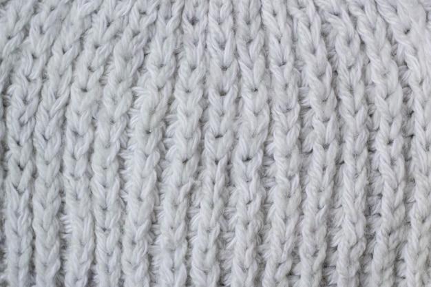 Modello della sciarpa o del maglione di fondo di struttura del tessuto tricottato bianco
