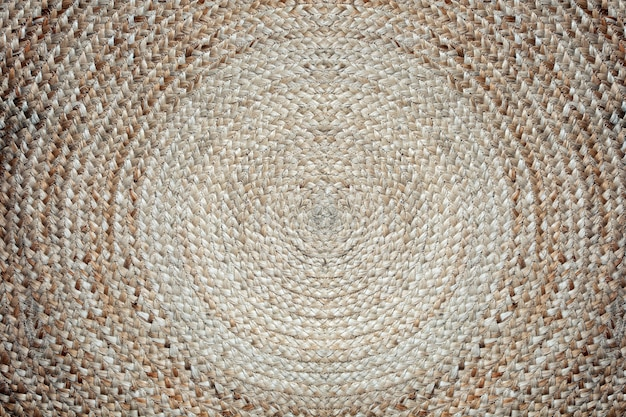 Modello della stuoia del tessuto, struttura rotonda del fondo di colore marrone del cerchio della stuoia di vimini
