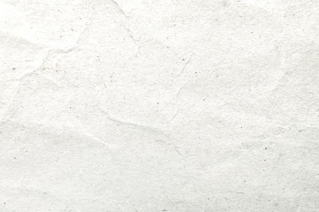 Modello di carta e fondo di struttura sgualciti bianco.