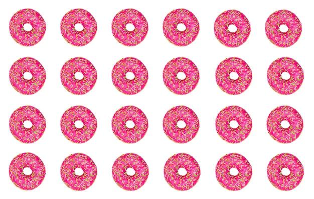 Modello di ciambelle rosa su uno sfondo bianco